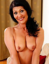 Smiling mature in sexy lingerie