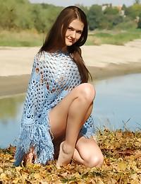 Gorgeous Olga L strips outdoors for us.