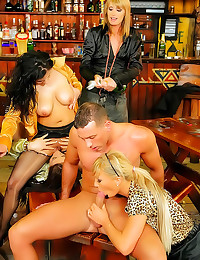 Dressed chicks in hot orgy