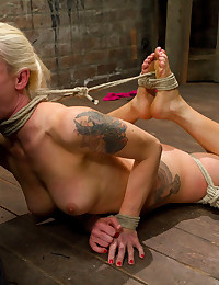 Pretty bondage girl serves man