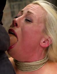 Pretty bondage girl serves man