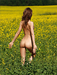 Alisa bares it all on a Field Of Gold.