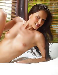Slender brunette in bed