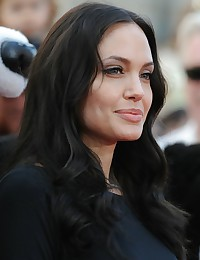 Pictures of Angelina Jolie wearing a very hot sexy black dress