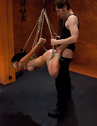 Hanging bondage girl