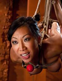 Hanging bondage girl