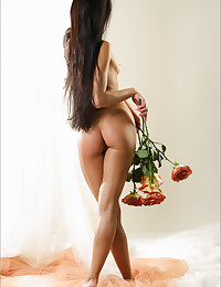 Maria gets her naked body all covered in roses.