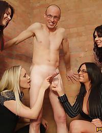 Clothed women stroking guy un...