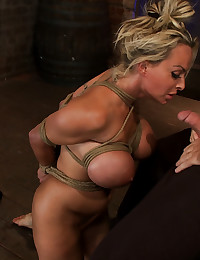 Busty blonde in ropes sucks cock
