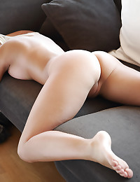 Sexy Miela strips on the couch.