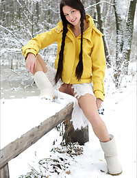 Maria gets completely naked out in the snow.