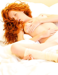 Pure redhead beauty in bed