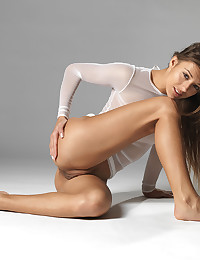 Sexy gymnast naked in a fishnet.