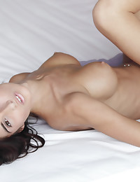 Hot brunette looks perfectly pink.