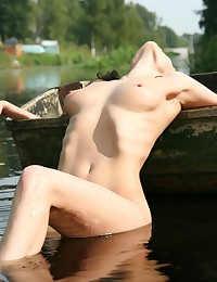 Mariana H gets in the lake completely naked.