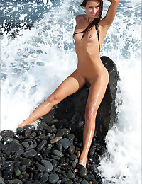 Maria bares it all at the beach for our delight.