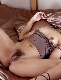 Hairy pussy Asian on satin sheets