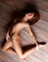 Ksenia gets down on the floor completely naked for MPL Studios.